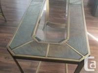 Brass & glass top and in perfect condition.Coffee table