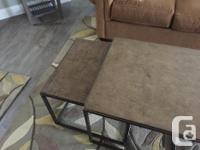 Stone surface, end tables will slide under coffee table