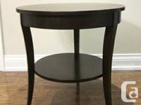Elegant dark coffee table with small shelf on bottom.