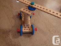 Many pieces of wood and plastic; screws, nuts, bolts,
