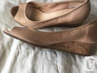 Sexy nude Cole Haan peep-toe wedges take your outfit to