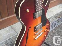 Collings Soco 16 lc. Holding the Collings in hand, the