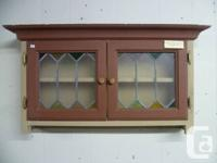 Painted two door wall cabinet, c/w tarnished glass
