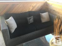 Plastic coated wicker sofa and 2 chairs and coffee