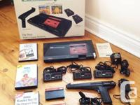 This is an original 1980s SEGA Master System with box.