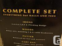 Complete Powerbilt Momentum golf set, including