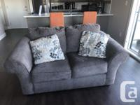 Like new !!! Couch, love seat, and coffee table. All