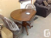 New 3 piece dining set. Table has drop down side fallen