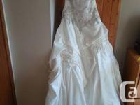 This stunning wedding event gown has never been used. I