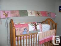 Storkcraft baby crib + quality bed mattress, matching