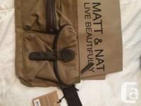 I am marketing:.  - off-white Aldo purse with black