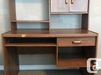 Sturdy wooden desk. Two pieces (top and bottom). Ample