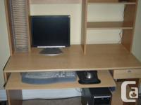 Computer desk with pullout keyboard shelf and drawer.