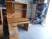 Oak computer desk with hutch and storage. Computer