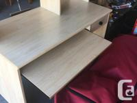 Has pull out keyboard drawer, tower shelf and printer