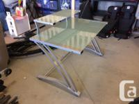 Computer desk in excellent condition. Tempered glass