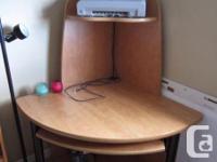 Marketing a corner computer/work desk. Oak surface.