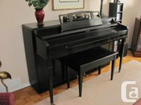 Attractive, compact black piano by Winter (New York and