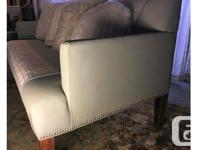 Compact crisply tailored three seater sofa with clean