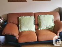 2 seat contemporary sofa. Brown with black trim. Feels