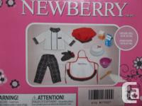 Newberry cooking outfit with accessories and cake.