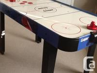 Very good condition air hockey table, works well, extra