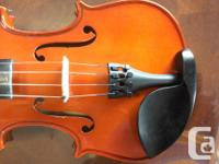 This fiddle has no scratches... Excellent condition.