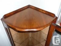 Beautiful Mahogany/Walnut curio cabinet. The cabinet is
