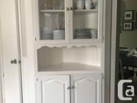 We are selling a solid wood corner hutch. The hutch has