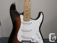 This is a Cort electric strat style guitar. it features