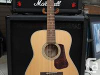 Description: The L100C has a solid spruce top for a