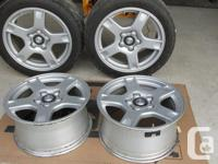 Set of 4 wheels in good condition ( 2 with tires that