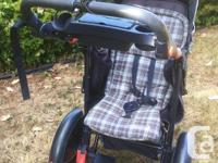 Sturdy Costco 3 wheeled stroller with hand brake
