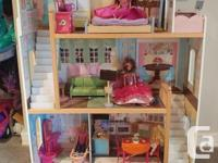Awesome condition Doll house complete with a ton of