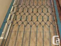 SELLING a SOLID STEEL BORDERED COT. SPRING SEASONS to