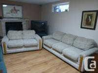 Light coloured modern three-seater couch with matching