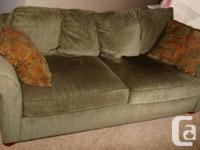 Light Green Couch and matching Ottoman. Comes with 4