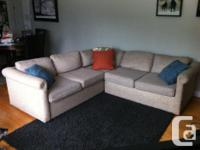 Stock # 6723. Tan coloured sectional couch for sale.