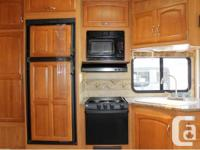 "2008 Cougar 291RLS 5th Wheel. Overall length 30'10"","