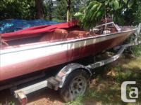 15 foot Cougar boat-1968 Evinrude boat motor-1988- 140