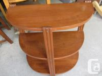 THIS HALF MOON END TABLE IS MADE OF SOLID WOOD. IT IS