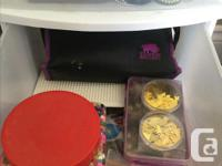 2 plastic storage towers filled with craft supplies.