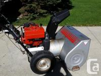 "A Craftsman 8hp with a 28"" cut. Has electric start and"