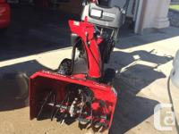 """9 HP , 27"""" two stage, power propelled snowblower."""
