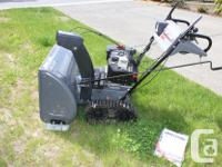 """8 hp Steerable Trac """"snowthrower"""" with electric start."""