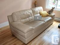 Hi,  I'm selling my cream leather couch cause i'm