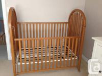 Solid oak crib in excellent condition, mattress