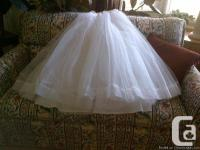 This is a three layer rigid nylon crinoline, to be wore