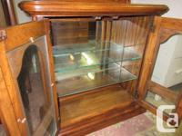 All wood smaller curio cabinet. 2 glass shelves and