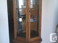 For sale beautiful Canadian made three sided Oak curio